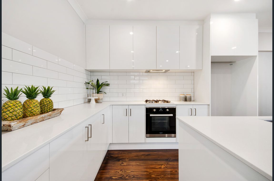 white kitchen renovation with timber floors