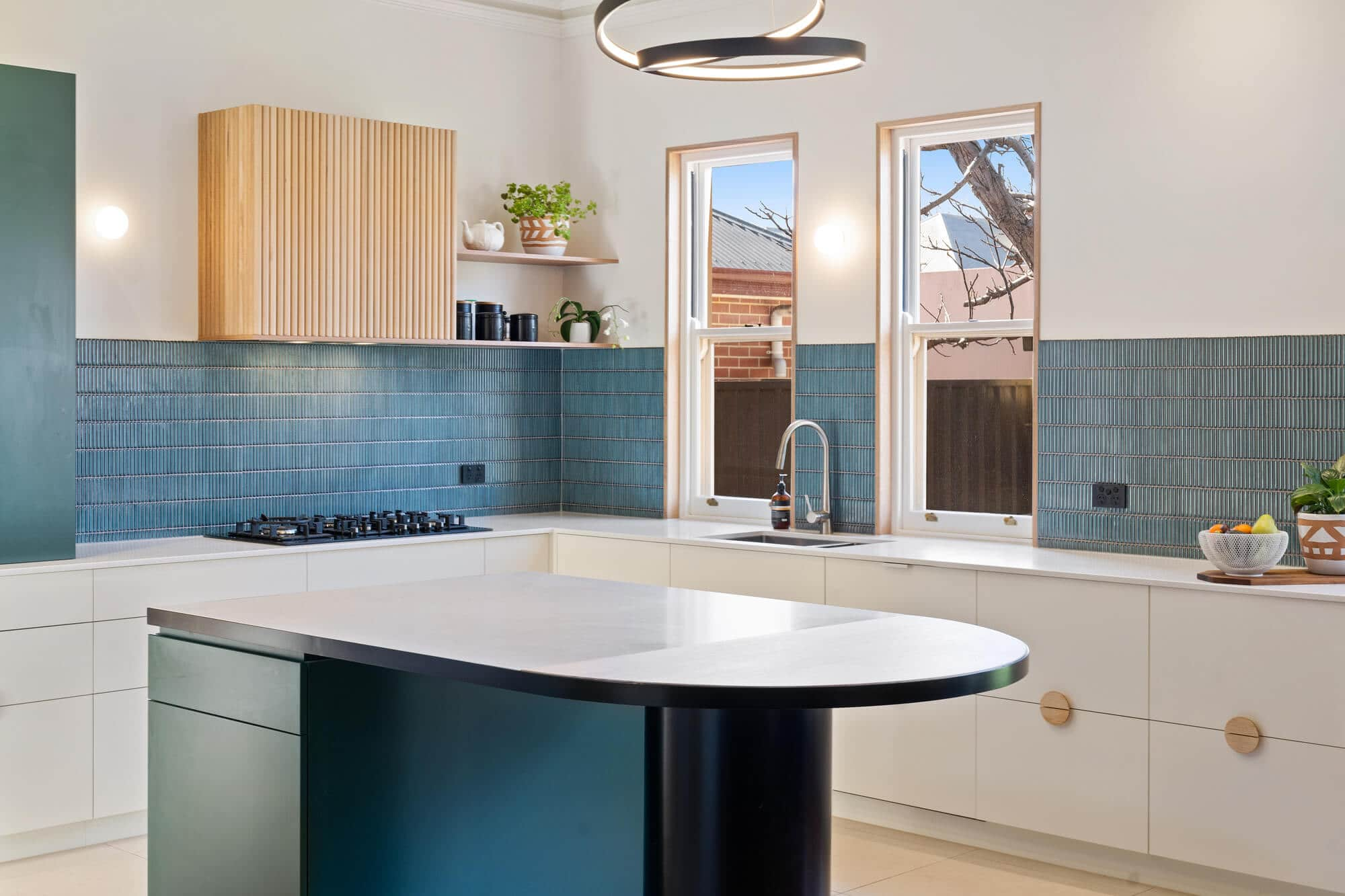 modern turquoise kitchen renovation with island